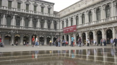People walking in front of Museo Correr during floods in Venice Stock Footage