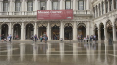 Adults and children standing during floods in front of Museo Correr in Venice Stock Footage