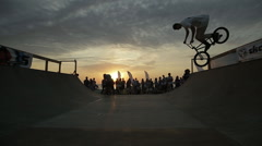 Young Man Jumping And Riding on A BMX Bike at dusk on the coast - stock footage