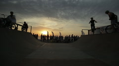 Young Man Jumping And Riding on A BMX Bike at dusk on the coast Stock Footage