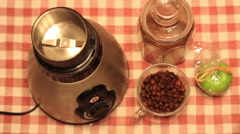 Grinding coffee beans in an electronic coffee grinder Stock Footage
