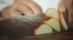 Chef cutting an apple with shallow depth of field Stock Footage