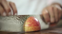 Chef cutting a apple with knife skills - stock footage