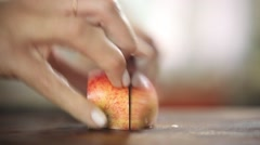 Chef cutting an apple with very low depth of field Stock Footage