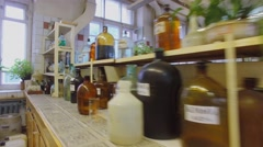 Shelves with many different reagents in bottles at laboratory - stock footage