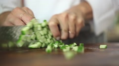 Chef cutting a cucumber Stock Footage