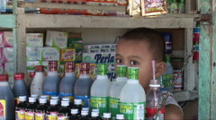 Young boy in shop in Kota Kinabalu Stock Footage
