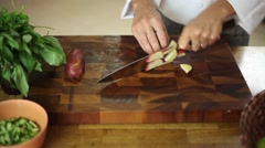 Chef cuts a potato with knife skills Stock Footage