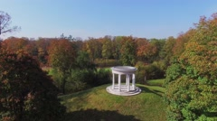 Antique style building among plants in Ostankinsky park at autumn Stock Footage