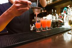 Barman stir alcohol Stock Photos