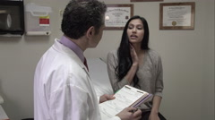Woman talking to doctor about symptoms. - stock footage