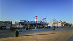 Sunset near brighton beach amusement park in New York Stock Footage