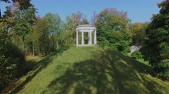 Public garden Ostankinsky with ancient style round building Stock Footage