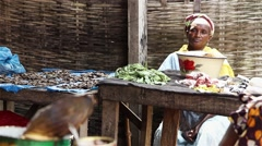 Fry fish streetsellers woman Stock Footage
