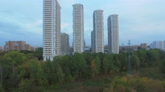 Residential complex near park and territory with piles of stones Stock Footage