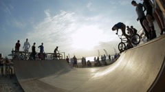 Bmx Rider performing Stunts on The Bike at sunset. Bmx-vert. - stock footage