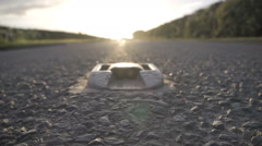 British Countryside Road At Sunset With Catseyes Reflective Safety Device Stock Footage