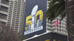Super Bowl 50, Building with football banner Stock Footage