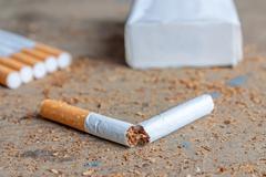 Anti-smoking background with broken cigarettes - stock photo