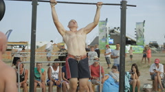Athlete Doing Pull-ups With Weights on The horizontal bar - stock footage