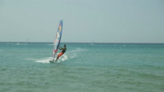 Young Man Engaged in Windsurfing in Sea Stock Footage