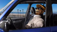Puppet Monkey Driving At The Beach Stock Footage