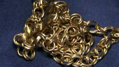 Gold Chain Falling Slow Motion Stock Footage