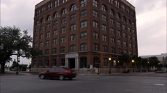 Tilting up shot of the Texas School Book Depository at Dealey Plaza, Dallas. Stock Footage