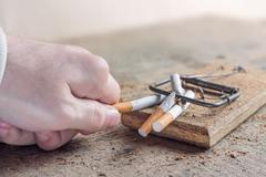 Stock Photo of Antismoking background with broken cigarettes. Quit smoking