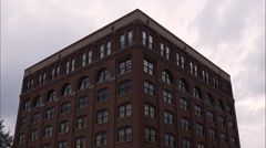 Tilting down shot of the Texas School Book Depository at Dealey Plaza, Dallas, Stock Footage