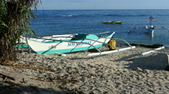 Man working on his catamaran Boat  at the beach of Balicasag Island Stock Footage