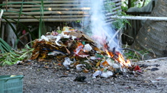 Close up from burning garbage at the beach Stock Footage