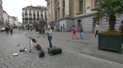 Woman playing an oboe in front of Brussels Stock Exchange, Brussels Stock Footage