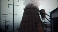 1971: Steam rising from industrial factory lumber mill processing plant. Stock Footage