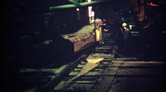 1971: Timber cutting logging factory lumber mill automated board maker. Stock Footage
