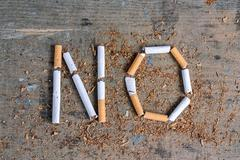 No word of a cigarette. Antismoking background Stock Photos