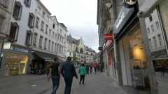 Walking on Rue des Fripiers near Paul patisserie shop in Brussels Stock Footage