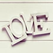 three-dimensional letters forming the word love, filtered - stock photo