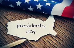 The flag of the US and the text presidents day, vignetted Stock Photos