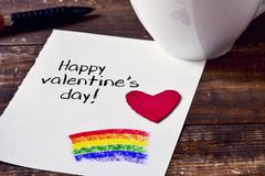 Coffee and note with text happy valentines day Stock Photos