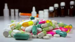 Big stack of medicine, pills, tablets + flasks, bottles and tubes - zoom in Stock Footage