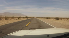 Driving On Deserted Highway In Dusty Mojave Desert- Baker California Stock Footage