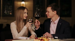 romantic date a guy and a girl in a restaurant - stock footage