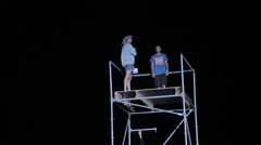 Young Man Making Flips From a Height to the Big Airbag at Night Arkistovideo