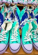 Green and blue sneakers - stock photo