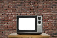 Old Television with Cut Out Screen and Brick Wall Stock Photos