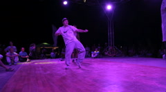 Stock Video Footage of Young Guy is Dancing popping during Dance Battles on the dance floor