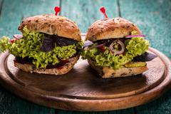 Veggie beet and quinoa burger,healthy food,vintage filter - stock photo