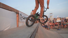 Stock Video Footage of Athlete Making Tricks on A BMX Bicycle on a Ramp during the competition.