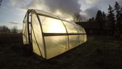 Polyethylene greenhouse in autumn, time lapse 4K - stock footage